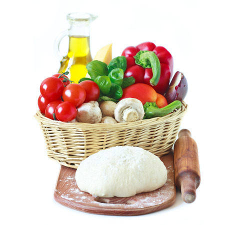 Homemade, cheese and vegetables for pizza on white background. photo