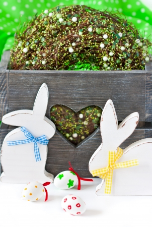 Easter decorations with white wooden bunnies  and spring wreath. photo