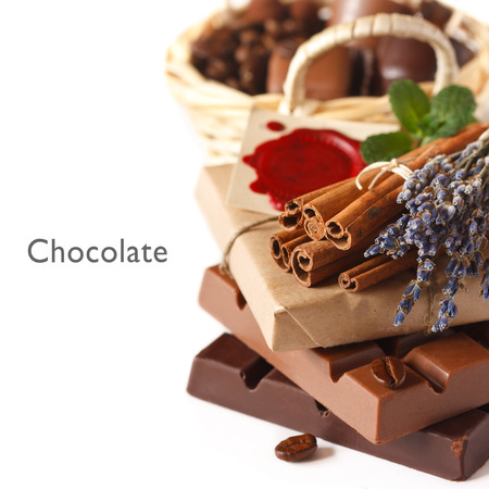 Chocolate bars with spices on a white background. photo