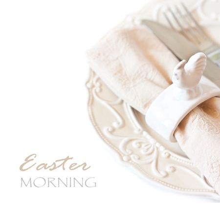 napkin ring: Easter table setting with porcelain chicken napkin ring and silver fork. Stock Photo
