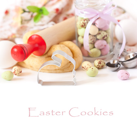 Easter composition with bunny cookie cutter and chocolate Easter eggs. photo