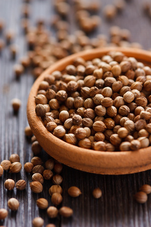 Coriander seeds in a bowl close-up.
