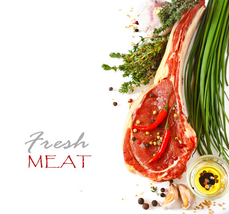 Fresh raw meat, spices and vegetables on a white background. Stockfoto