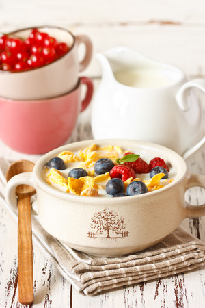corn flakes: Corn flake cereal with milk and berries for breakfast.