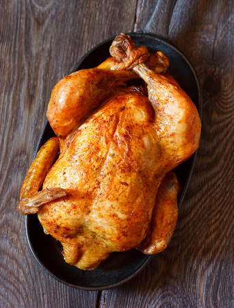 oven chicken: Whole roasted chicken on a pan. Rustic style. Stock Photo