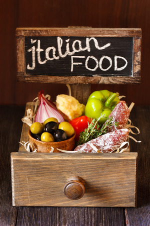 Delicious italian food in a wooden rustic box. photo