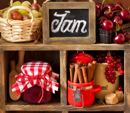 jam jar: Ingredients for cooking jam. Fresh berries, spices and brown sugar on an old rustic shelves. Stock Photo