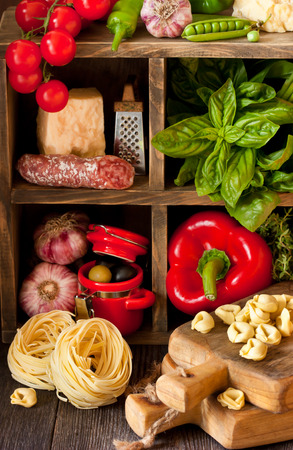 rustic kitchen: Italian food. Fresh food ingredients for cooking on a rustic kitchen. Stock Photo
