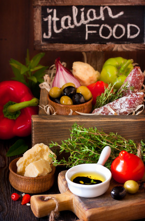 Delicious italian food ingredients in a wooden rustic box. photo
