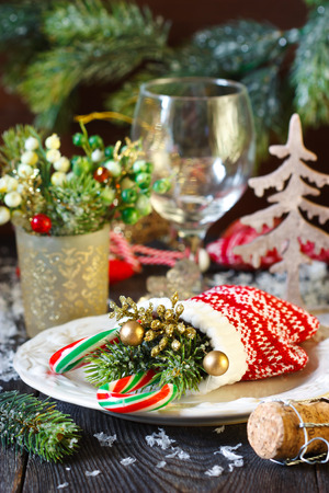 fine cane: Christmas table setting with decorative mitten. Stock Photo