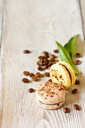 Fresh sweet macarons with coffee. Food background with copy space. photo
