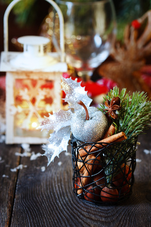 Christmas place setting with candle lantern. photo