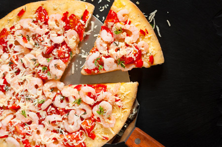 Fresh hot shrimp pizza on a chalk blackboard. photo