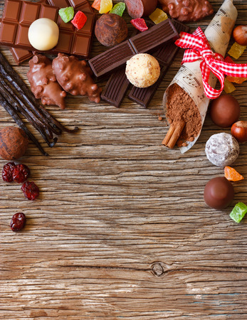 candy bar: Delicious chocolates and spices on a white background.