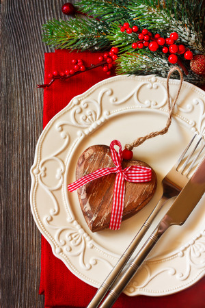 Christmas table setting with decorative wooden heart. photo