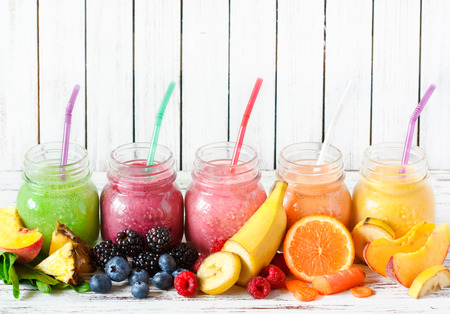 the juice: Healthy smoothies with fresh ingredients on a kitchen board. Stock Photo