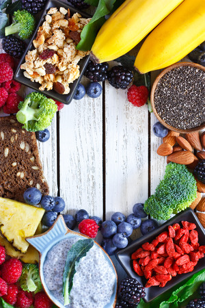 superfood: Superfood. Frame of healthy vegan ingredients on white wooden board.