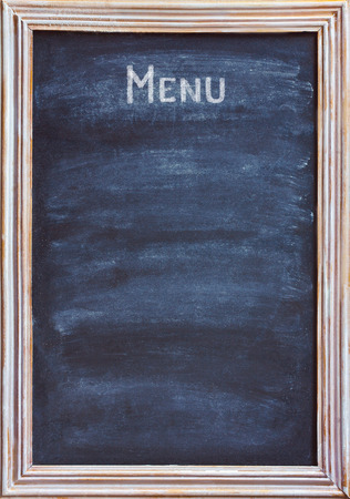 antique sleigh: Old blackboard with white chalk and eraser for menu or price. Stock Photo