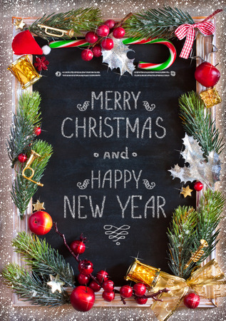 Chalk blackboard Christmas congratulation with Christmas decorations. Retro style. Christmas card.