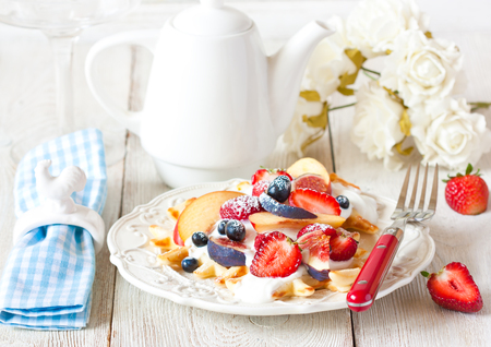 waffle: Fresh homemade waffles with whipped cream and fruit for breakfast. Stock Photo