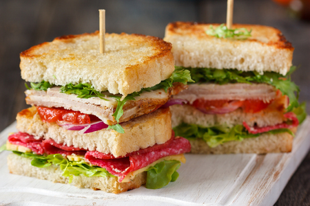 chicken sandwich: Fresh turkey sandwich with cheese, sausage and vegetables.