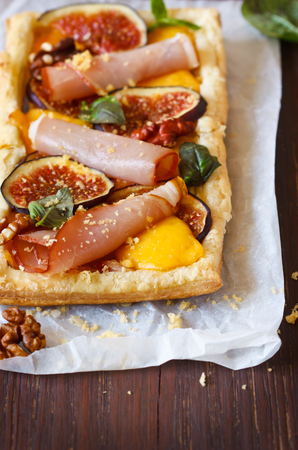 puff pastry: Homemade fig prosciutto puff pastry pie closeup. Stock Photo
