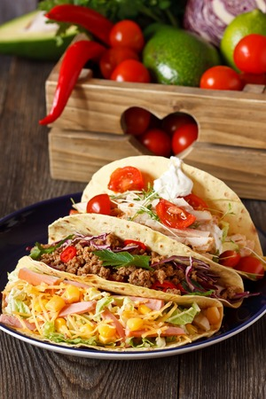 food on table: Fresh delisious mexican tacos and food ingredients. Stock Photo