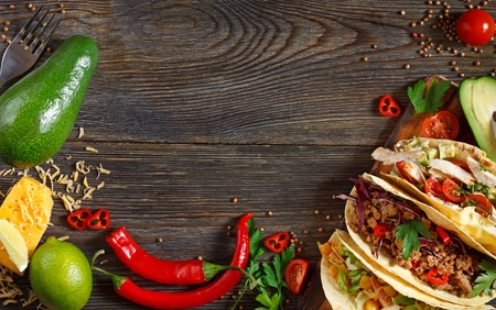 street food: Fresh delisious mexican tacos and food ingredients. Stock Photo