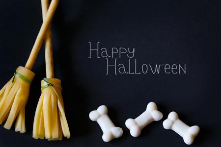 pretzel stick: Halloween pretzel stick cheese broom and sugar bones on black.
