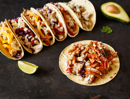 Varied traditional mexican corn tacos flat lay composition Stock Photo