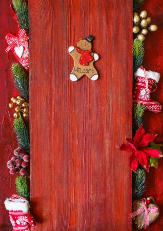 Decorative wooden gingerbread man on vintage red  with copy space for greeting, menu or your text.