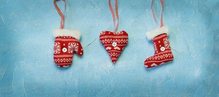 Christmas red decorations hanging on a blue
