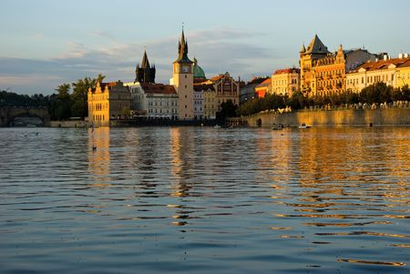 vltava: The sun evening view on the Prague with Vltava near the Charles bridge, Czech. Stock Photo