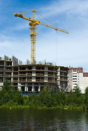 Under construction modern house on river bank, Russia Stock Photo