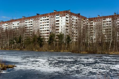 The panel apartment house on river bank in suburb of Saint-Petersburg, Russia Stock Photo - 5093857