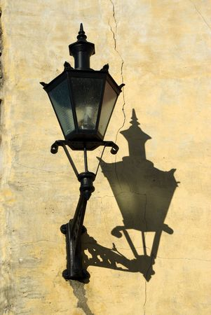Decorative lantern and its shadow on a old Tallinn wall photo