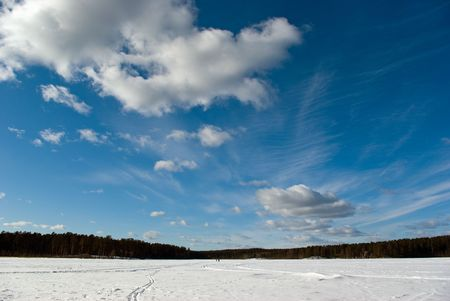Winter landscape: snow-covered lake and sky Stock Photo - 5661869