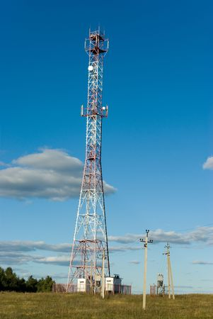 Cell phone tower in countryside photo