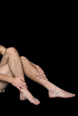 hairy male: Male hairy legs and arms against a black background
