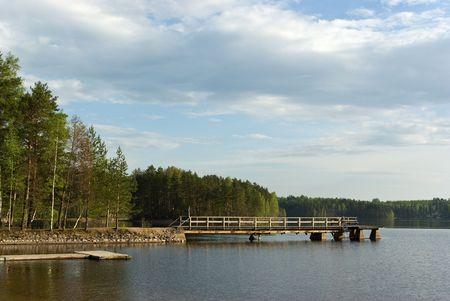 Spring evening Saimaa lake with pier. Imatra. Finland Stock Photo - 7058635