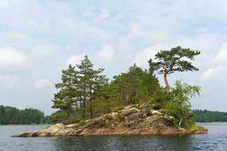 Rocky island in the Pihlajavesi (Saimaa) lake. Finland Stock Photo - 7511043