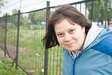 Outdoors portrait of smiling girl