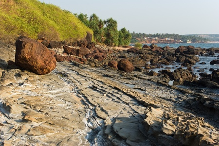 Rocky coast of Arabian sea between Vagator and Anjuna beach in Goa photo