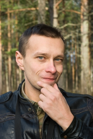 brune: Portrait of thinking man in forest