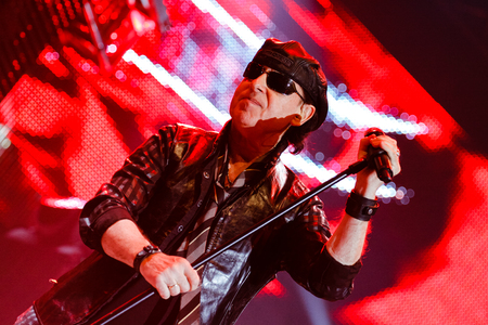 """Chelyabinsk Russia - April 22, 2012: Concert of the German rock band Scorpions in the Palace of Sports """"Yunost"""". In the photo: vocalist and guitarist Klaus Meine"""