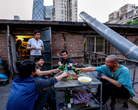 migrant: migrant workers having fun together Editorial