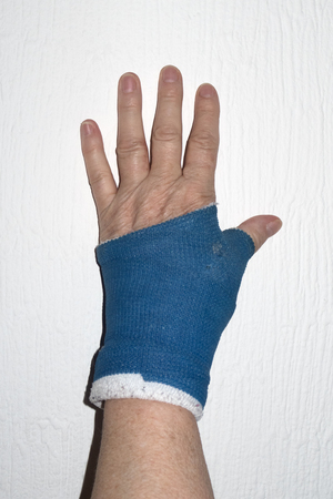 hand with blue bandage