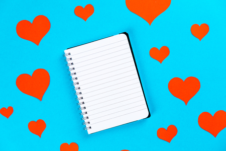 paper on a blue background with red hearts Фото со стока