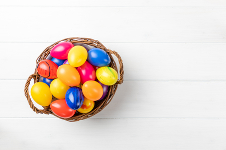 colorful easter eggs in a nest with white background