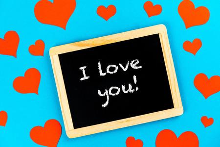 chalkboard with red hearts on a blue background Reklamní fotografie